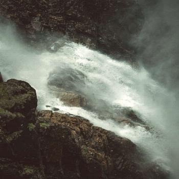 Dark and moody waterfall in Norway -