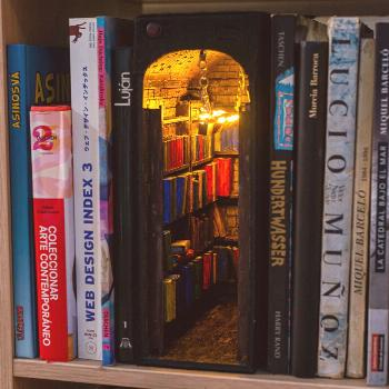"""T nice Alby Martin – Alby's """"book nook"""" is a bookcase-within-a-bookcase with its own light."""